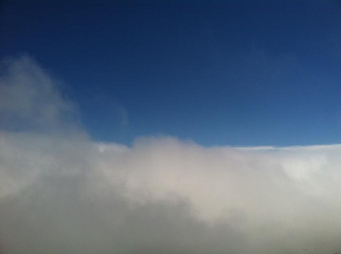 blue sky above fog